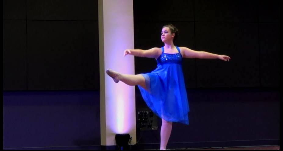 Girl dancer in blue dress