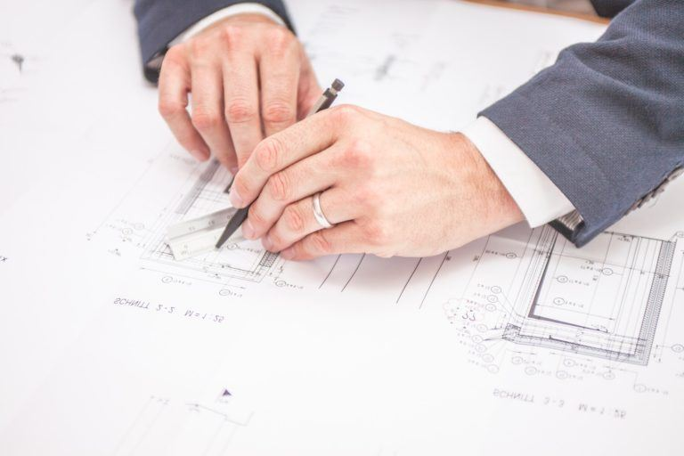 Hands Drawing Planning Maps