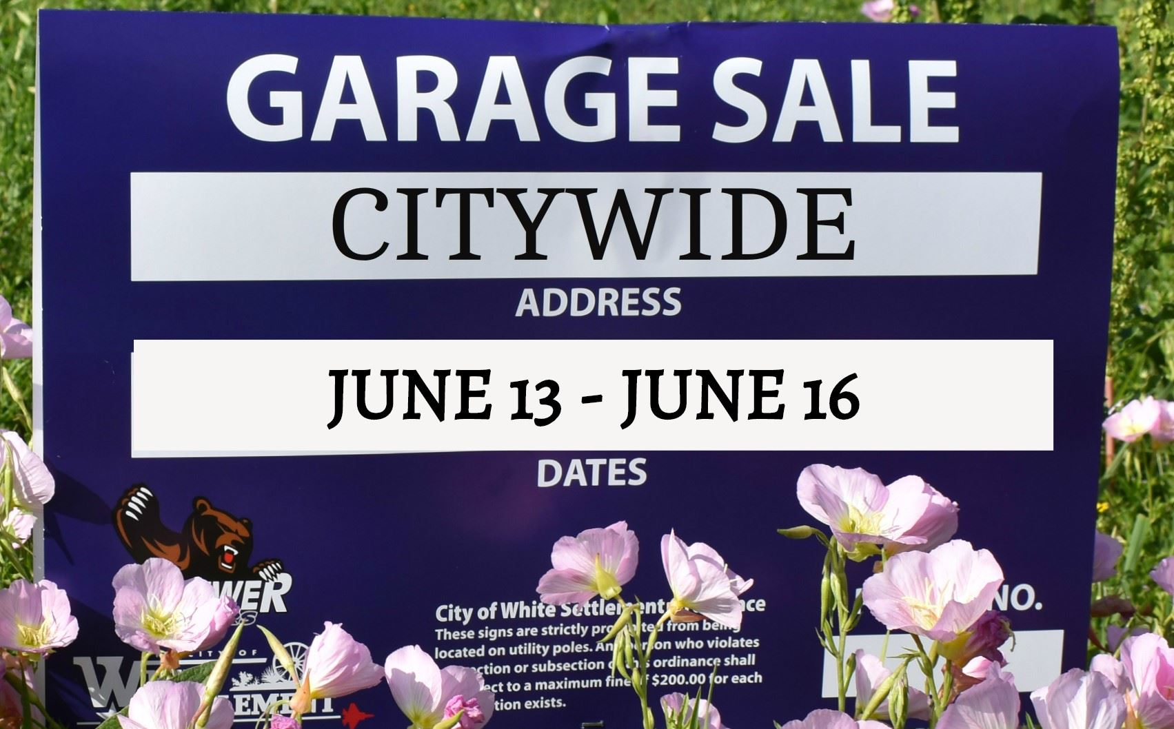 sign advertising a garage sale