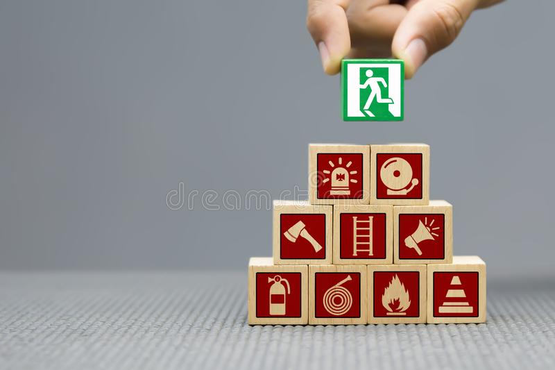 close-up-image-hand-selected-graphic-symbol-fire-exit-wooden-blocks-toy-escape-icons-concepts-159251